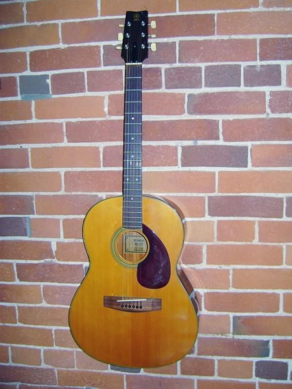 Yamaha High Strung - Maggie's first guitar in Instruments by 
